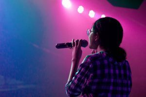 Confident Singer Takes the Stage
